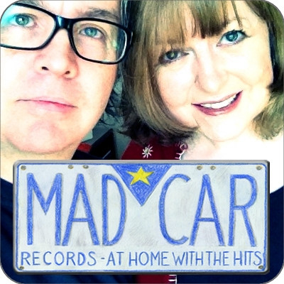 Marjorie and David with Madcar Logo (square with rounded edges)